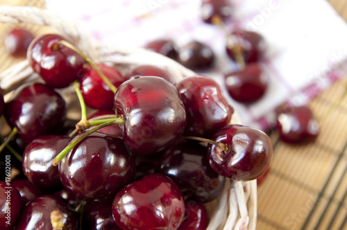Fotobehang Kersen Basket full of fresh cherries