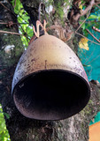 Old gilded bell hanging on a tree, Buddhist temple Wat That, Vang Vieng, Vientiane Province, Laos - 176021859