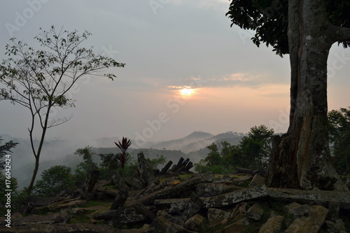 Sunrise at the megalithic site in West Java, Indonesia Poster