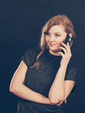 Attractive woman flirting texting on mobile phone. - 176043868
