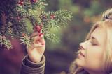 Woman dressed warmly looking at bush