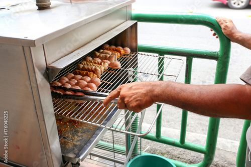 Local seller cook Northeast Thai style meat sausage at Udomsuk fresh market, Ban Poster