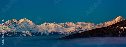 Deurstickers Groen blauw Scenic panorama sunset landscape of Crans-Montana range in Swiss Alps mountains with peak in background, Crans Montana, Switzerland.