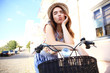 Charming woman on bike in city, during summer