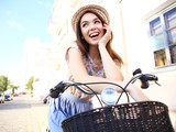 Charming woman on bike in city, during summer - 176049448