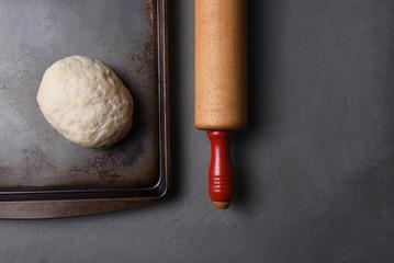 A ball of raw bread dough on a baking sheet