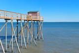 Fisherman huts at the coast - 176059409