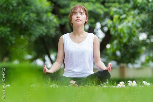 Fototapeta Closeup of beautiful asian women doing yoga in park