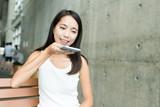 Woman sending audio message on cellphone - 176065444