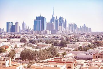 Color toned picture of Dubai skyline, United Arab Emirates.