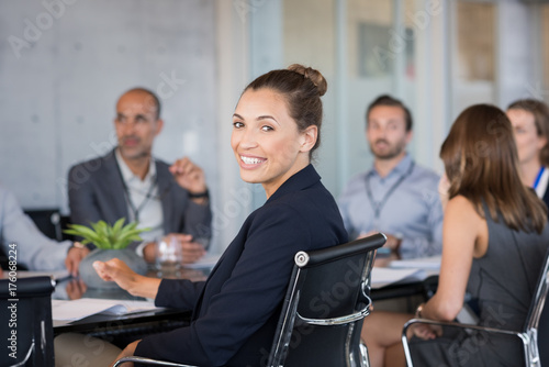 Young businesswoman attending meeting