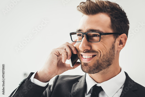 businessman talking by phone - 176070860
