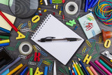 Back to school. Set of school objects for modern education: pens, scissors, pensils and other multicolored accessories on wooden desk - 176076604