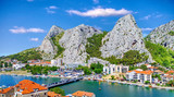 Coastal town of Omis surrounded with mountains in Croatia, Croatian travel landmark at Adriatic sea - 176078282