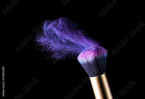 Aluminium Abstractie Make-up brush with pink powder explosion isolated on black background