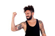 Winner handsome bearded man with tattoos on his body