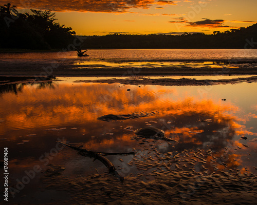 Aluminium Zwart Red and gold sky of sunset reflected in the Gonubie river near East London, South Africa