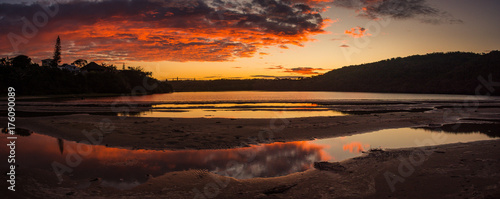 In de dag Chocoladebruin Red and gold sky of sunset reflected in the Gonubie river near East London, South Africa