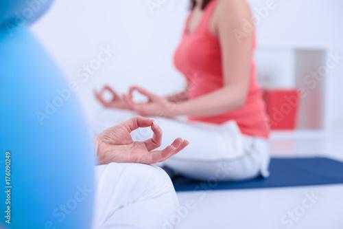 Fototapeta Pregnant Woman Practising Yoga