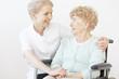 Quadro Smiling caregiver hugging senior woman