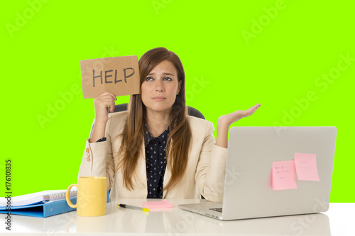 young attractive sad and desperate businesswoman suffering stress at office laptop computer desk green croma key background - 176101835