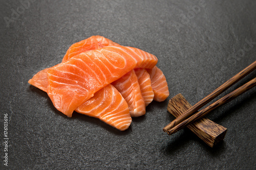 Foto op Canvas Sushi bar salmon with japan chopstick background
