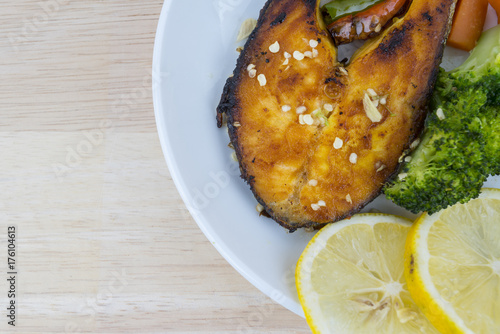 Grilled Salmon with fresh salad and lemon. Selective focus - 176104613