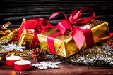 gifts boxes with fir branches on wooden background close up - 176107035