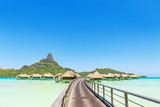 Overwater pass to villas on a tropical lagoon of Bora Bora Island, Tahiti, French Polynesia - 176109655