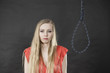 Suicidal woman next to hanging rope with knot - 176115681