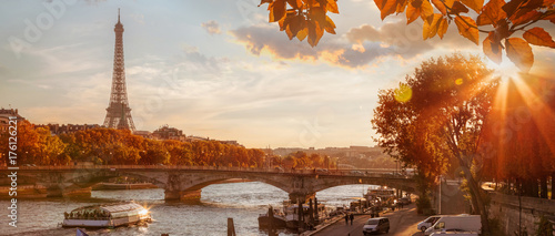 Paris with Eiffel Tower against autumn leaves in France - 176126221