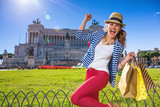 cheerful woman in Rome, Italy with shopping bags rejoicing - 176126662