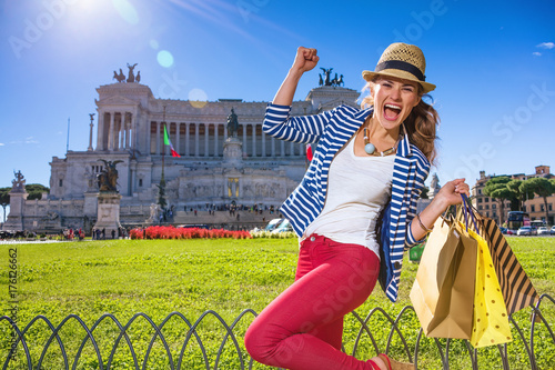 cheerful woman in Rome, Italy with shopping bags rejoicing Poster