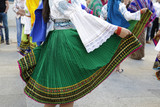 Woman dancing and wearing the traditional folk costume from Ecuador, South America - 176128297