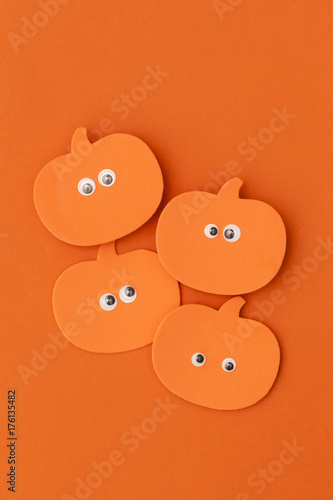 Halloween pumpkin character shape with funny googly eyes - 176135482