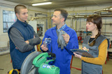 teacher explaining workers why wear protective equipment - 176137433