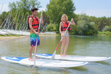 silhouette of perfect couple engage standup paddle boarding - 176140423