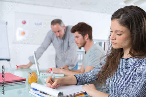 students writing something during class - 176142619