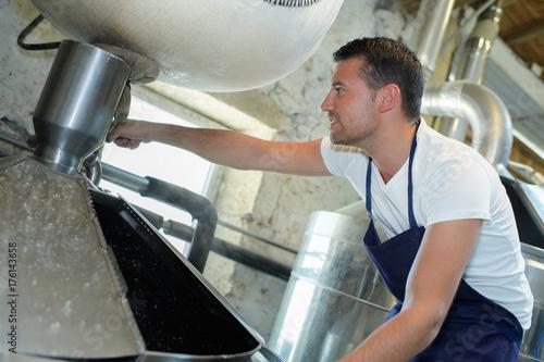 man adjusting vat