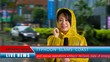 Weather reporter reporting on storm