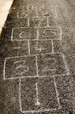 Hopscotch drawn on a road with chalk - 176147089