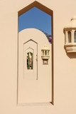 Fragments of traditional eastern architecture. Line of portals on blue sky background - 176148805