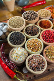 Variety of different asian and middle east spices, colorful assortment, on old wooden table - 176155028