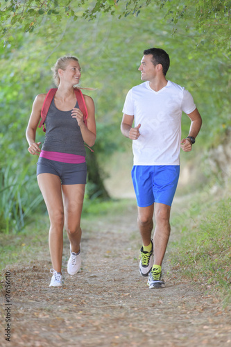 Deurstickers Jogging couple jogging in the woods