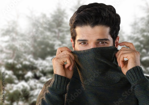 Man with warm jumper in snow forest Poster