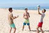 boys playing beach volleyball