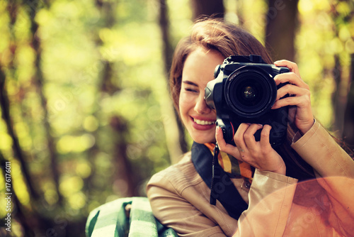 woman is a professional photographer with photo camera - 176176011