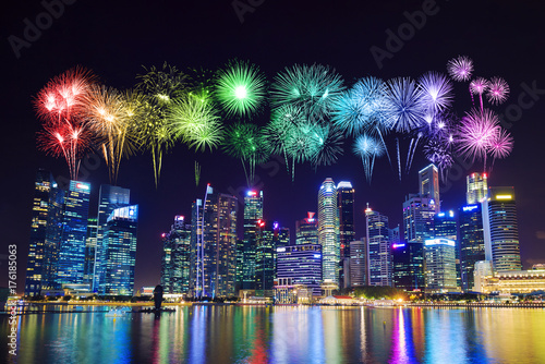 beautiful firework over central business district building of Singapore city at Poster