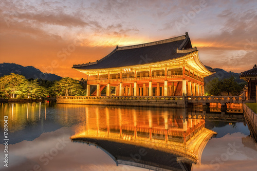 Gyeongbokgung Palace At Night In South Korea, with the name of the palace 'Gyeon Poster