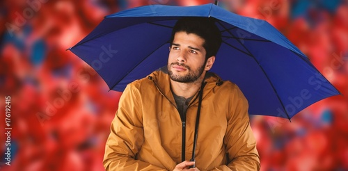 Fotobehang Rood traf. Composite image of thoughtful man standing with umbrella